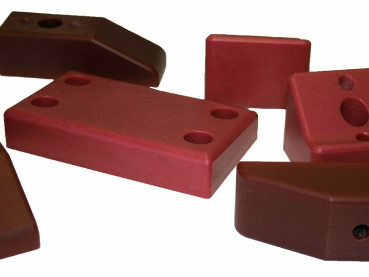 """New Material Alert"" – Wax Filled Maroon Machined Nylon Parts"